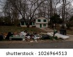 Small photo of Trash Pile in Front of an abandoned House