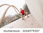 man training with the rope | Shutterstock . vector #1026979207