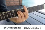 Small photo of Accord barre on guitar correct setting hand on the fretboard instrument close-up