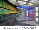 Small photo of CHICAGO, IL -11 FEB 2018- The colored electric neon tunnel The Sky Is the Limit at Chicago O'Hare International Airport (ORD) connects the B and C concourses at the United Airlines (UA) terminal.