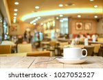 cup of coffee on table in cafe | Shutterstock . vector #1027052527