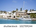 Sailing ship along the waterfront of the town of St. George's, Bermuda. - stock photo