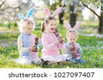 kids with bunny ears on easter... | Shutterstock . vector #1027097407