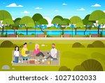 happy people having picnic in...   Shutterstock .eps vector #1027102033