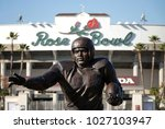 Small photo of Pasadena, CA / USA - Feb. 17, 2018: A statue of the color barrier breaking, multi-sport athlete, Jackie Robinson, is shown in his college football attire outside the Rose Bowl Stadium.