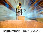 warehouse worker dragging... | Shutterstock . vector #1027127023