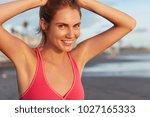 cheerrful sportswoman with... | Shutterstock . vector #1027165333
