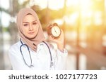 medical staff and clock with... | Shutterstock . vector #1027177723