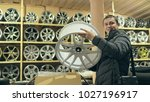 the man buys alloy wheels in... | Shutterstock . vector #1027196917