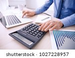 man working at table in office  ... | Shutterstock . vector #1027228957