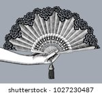 female hand with open fan.... | Shutterstock . vector #1027230487
