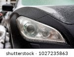 black car coated ice crust... | Shutterstock . vector #1027235863