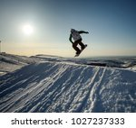 jumping snowboarder on... | Shutterstock . vector #1027237333