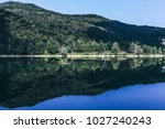 a mountain lake in a sunny day. ... | Shutterstock . vector #1027240243