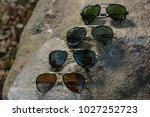 eyewear sun glasses photography  | Shutterstock . vector #1027252723