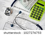 stethoscope and calculator... | Shutterstock . vector #1027276753