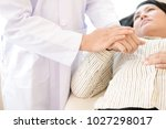 doctor with patient. routine... | Shutterstock . vector #1027298017