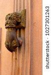 vintage door knocker like hand... | Shutterstock . vector #1027301263