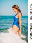 young fit woman in blue... | Shutterstock . vector #1027311247