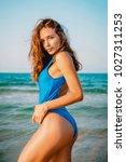 beautiful attractive woman in... | Shutterstock . vector #1027311253