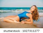 attractive woman in bikini... | Shutterstock . vector #1027311277