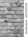 Small photo of Old deteriorated brick wall texture background in black and white.