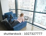 a girl with a laptop lying on... | Shutterstock . vector #1027327777