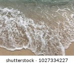 sea wave with bubbles hits the... | Shutterstock . vector #1027334227