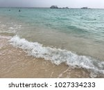 sea wave with bubbles hits the... | Shutterstock . vector #1027334233