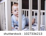a small child lies in a baby...   Shutterstock . vector #1027336213
