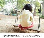 little baby sitting swing home...   Shutterstock . vector #1027338997