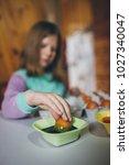 little girl enjoying in easter... | Shutterstock . vector #1027340047