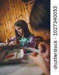 two girls enjoying in easter... | Shutterstock . vector #1027340053