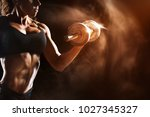Small photo of Muscular fitness woman doing exercises.Concept of healthy lifestyle. Cross fit bodybuilder in the gym.