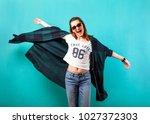 fashion girl in studio near... | Shutterstock . vector #1027372303