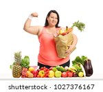 overweight woman with a paper... | Shutterstock . vector #1027376167