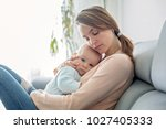 young mother  holding her sick... | Shutterstock . vector #1027405333