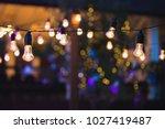 outdoor string lights hanging... | Shutterstock . vector #1027419487