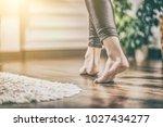 floor heating. young woman... | Shutterstock . vector #1027434277