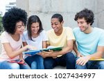 group of international students ... | Shutterstock . vector #1027434997