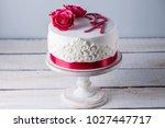 beautiful white wedding cake... | Shutterstock . vector #1027447717