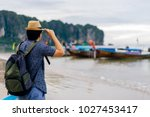 young man traveler with green... | Shutterstock . vector #1027453417