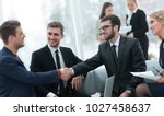partners concluding deal and... | Shutterstock . vector #1027458637