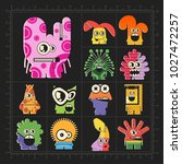 cute colorful monsters on black.... | Shutterstock .eps vector #1027472257