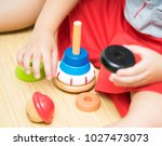 little child girl playing with... | Shutterstock . vector #1027473073