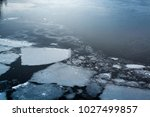 climate change with cracked ice ... | Shutterstock . vector #1027499857