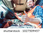 truck driver man sitting in... | Shutterstock . vector #1027509457