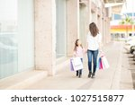 full length of a rich mother... | Shutterstock . vector #1027515877