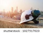 white safety helmet with... | Shutterstock . vector #1027517023