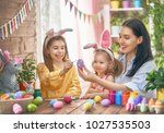 happy holiday  a mother and her ... | Shutterstock . vector #1027535503